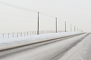 Telephone Pole Framed Prints - Desolate Winter Road Framed Print by Lynn Koenig
