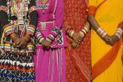 Dresses Prints - Detail Of Hands Four Women In Saris Print by Axiom Photographic