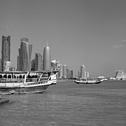 Doha Photo Framed Prints - Dhow trip in Doha Bay Framed Print by Paul Cowan