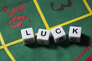 Spelling Framed Prints - Dice On A Gambling Table Spelling The Word Luck Framed Print by Larry Washburn