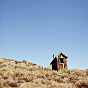 Ghost Town Outhouse Prints - Dilapidated Outhouse on Hillside Print by Eddy Joaquim
