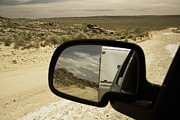 Rear View Mirror Prints - Dirt Road Through Desert Print by Ned Frisk