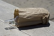 Abuse Prints - Discarded Rum Bottle In Paper Bag Print by Mark Williamson
