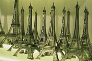 Kiosks Posters - Display Of Miniature Eiffel Towers Poster by Todd Gipstein