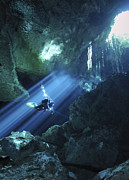Rays Of Light Prints - Diver Silhouetted In Sunrays Of Cenote Print by Karen Doody