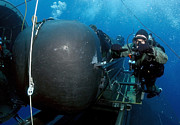 Submerge Photos - Divers Prepare To Launch A Seal by Stocktrek Images