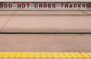 Information Prints - Do Not Cross Tracks Sign At Lightrail Print by Roberto Westbrook