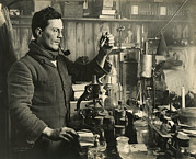 Smoking Book Framed Prints - Doctor Edward Atkinson In His Lab Framed Print by Herbert G. Ponting