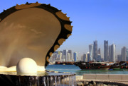 High-rise Prints - Doha fountain skyline and harbour Print by Paul Cowan