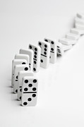 Balance In Life Photos - Dominoes Falling Over In A Chain Reaction by Larry Washburn