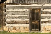 Log Cabins Framed Prints - Door And Detail Of Logs And Chinking Framed Print by Charles Kogod