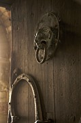 Old Iron Framed Prints - Door knocker of the Basilica Saint-Julien. Brioude. Haute Loire. Auvergne. France. Framed Print by Bernard Jaubert