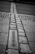 Berlin Germany Prints - Double Row Of Bricks Across Footpath And Road In Berlin To Mark The Position Of The Berlin Wall  Print by Joe Fox