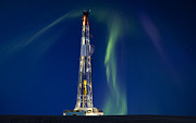 Winter Night Photo Metal Prints - Drilling Rig Saskatchewan Metal Print by Mark Duffy