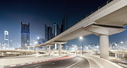 Long Street Prints - Dubai Cityscape With Bridges At Night Print by Spreephoto.de