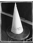 Dunce Framed Prints - Dunce Cap Framed Print by Emily Kelley