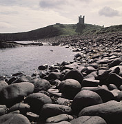 Leaning Building Framed Prints - Dunstanburgh Castle Framed Print by Dunstanburgh Castle