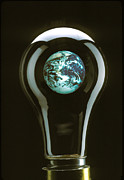 Round Framed Prints - Earth in light bulb  Framed Print by Garry Gay