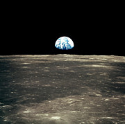 Rising From Earth Posters - Earth Rising Above The Moons Horizon Poster by Stocktrek Images