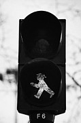 Crosswalk Posters - East German Ampelmannchen go walking traffic light man Berlin Germany Poster by Joe Fox