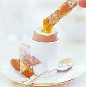 Egg-cup Photos - Eating A Boiled Egg by David Munns