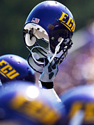Sports Photo Framed Prints - ECU Helmet Held High Framed Print by Rob Goldberg