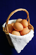 Wicker Basket Prints - Eggs in a wicker basket. Print by Gaspar Avila