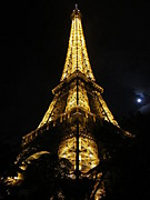 Moonlit Night Photos - Eiffel Tower Moon II Paris France by John A Shiron