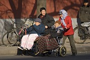 Poor People Prints - Elderly Chinese In Wheelchairs Print by Mark Williamson