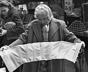 Candid Portraits Prints - Elderly Woman Evaluating A Corset Print by Everett