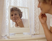 Senior Citizens Prints - Elderly Woman Putting On Make-up Print by Karen Brett