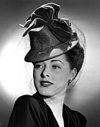 Eleanor Parker Wearing A Tall Crowned Print by Everett