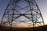 Silhouetted Posters - Electricity pylons at sunset Poster by Sami Sarkis