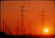 Transmission Prints - Electricity Transmission Lines At Sunset Print by David Nunuk