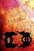 Indoor Still Life Prints - Elephant Silhouettes In Front Of A Map Print by Chris Knorr