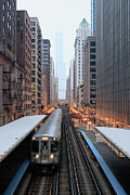 Illuminated Framed Prints - Elevated Commuter Train In Chicago Loop Framed Print by Photo by John Crouch