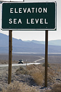 Road Trips Prints - Elevation Sea Level Sign And Highway Print by Rich Reid