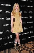 Gold Dress Framed Prints - Elle Fanning Wearing A Rodarte Dress Framed Print by Everett