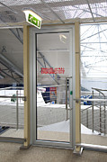 Tallinn Airport Photo Posters - Emergency Exit at an Airport Poster by Jaak Nilson