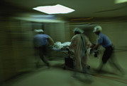 Bravery Prints - Emergency Medical Staff Rush A Patient Print by James L. Stanfield