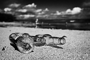 Litter Posters - Empty Beer Bottles And Plastic Bottle Discarded Littering A Beach In County Down Northern Ireland Poster by Joe Fox