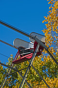 Not In Use Photo Posters - Empty chair on Ferris Wheel Poster by Thom Gourley/Flatbread Images, LLC