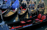 Boats On Water Photo Posters - Empty gondolas floating on narrow canal in Venice Poster by Sami Sarkis