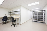 Florescent Lighting Prints - Empty Metal Shelves and Workstations Print by Jetta Productions, Inc