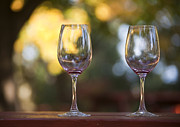 Relaxed Photo Framed Prints - Empty Wine Glasses on Patio Table Framed Print by David Buffington