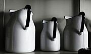 Jugs Photo Prints - Enamel Jugs Print by Larysa Luciw