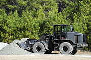 Loader Photos - Equipment Operator Gathers A Load by Stocktrek Images