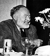 Author Prints - Ernest Hemingway Drinks Wine And Coffee Print by Everett