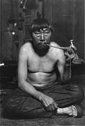 Barechested Prints - Eskimo Smoking Pipe, Photograph Print by Everett