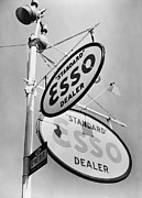 Branding Prints - Esso Gasoline Dealer Sign On Chestnut Print by Everett